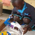 Children often match book themes to what they build, write, and draw. This girl made a train with colorful blocks, almost like the one in Freight Train. Integrated learning is prized in TEACH Rwanda schools.