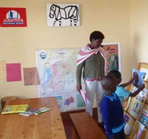 Children at Judith's Reading Room Muhanga choose from many books—all relevant to Rwanda