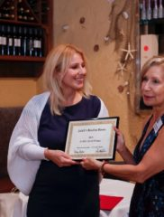 Linda preseting Judith's Award to Vicky Xanthopoulou